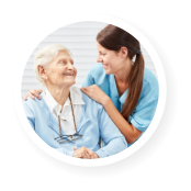 female caregiver and her old woman patient smiling to each other