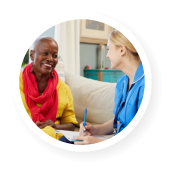 african patient happy talking to her caregiver