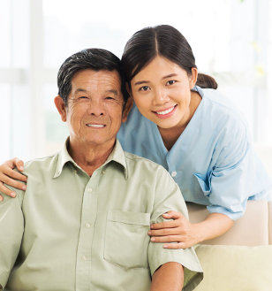 asian caregiver with her old man patient