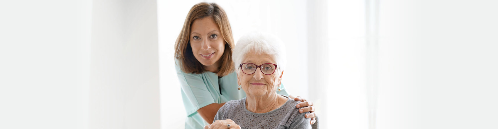female caregiver with her old woman patient